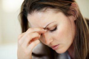 Closeup of woman suffering from headache